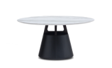 Unity dining table, combines smooth curves with a strong statement base which is wrapped in supple faux black leather.